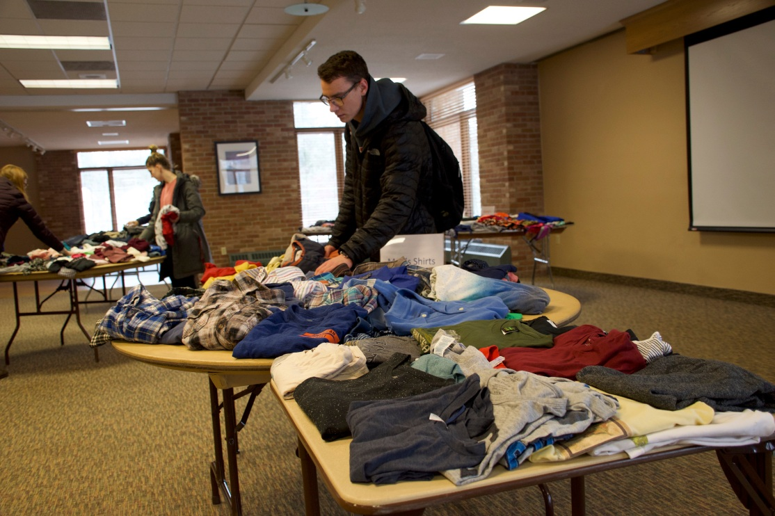 Students looking at clothing at SaintSwap