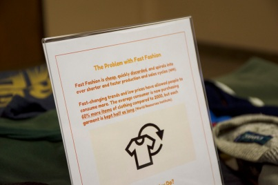 poster at event with information on fast fashion