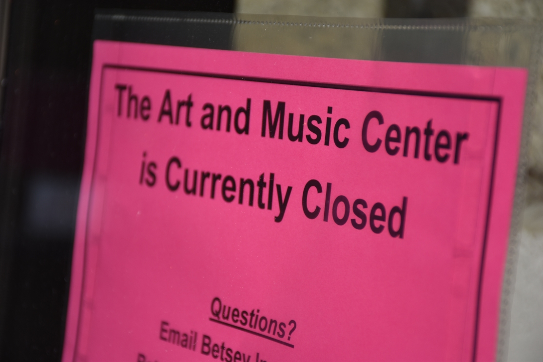 """Sign reading """"The Art and Music Center is Currently Closed"""""""