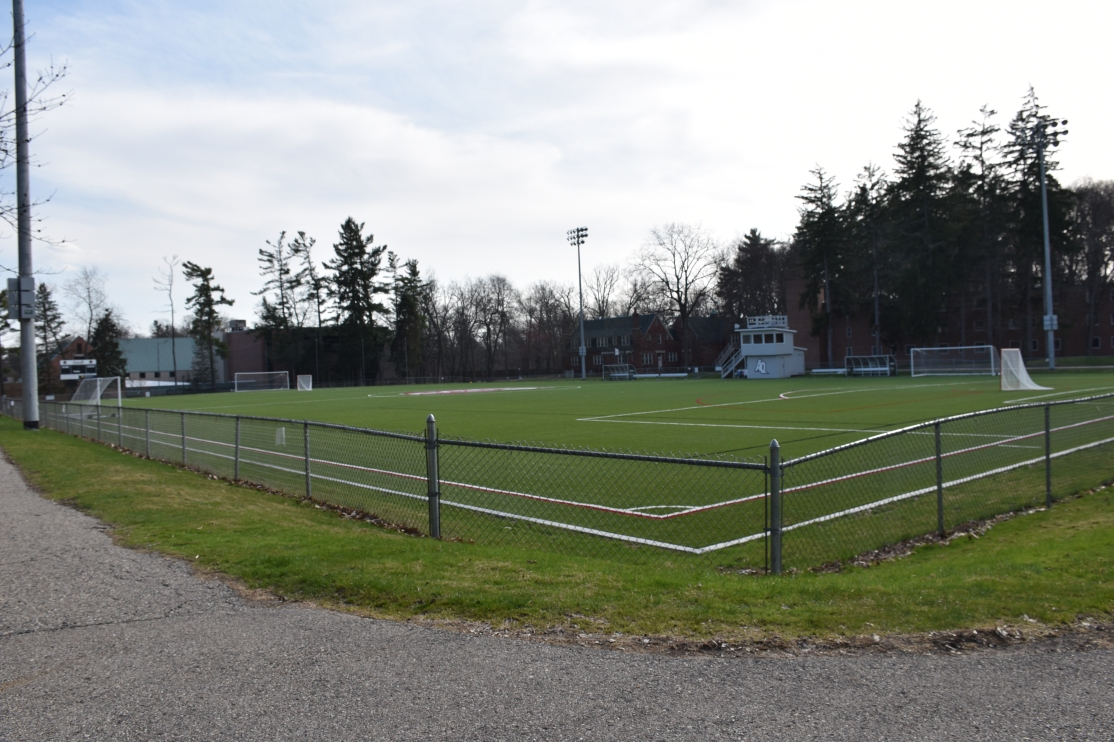 View of the empty athletic field from the fence