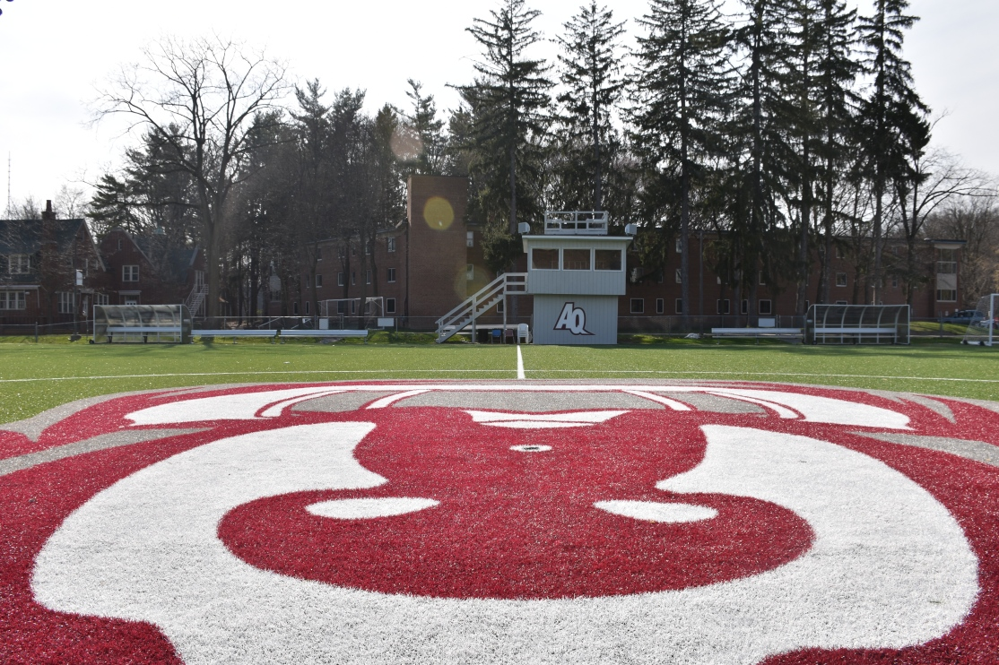 view of the athletic field from the logo of Aquinas' mascot on the turf