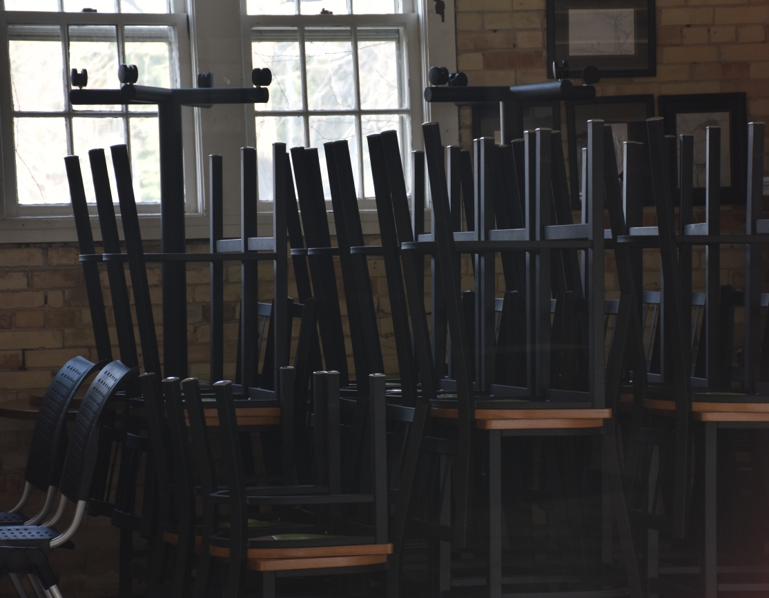 interior of the Moose Café, chairs stacked on top of each other