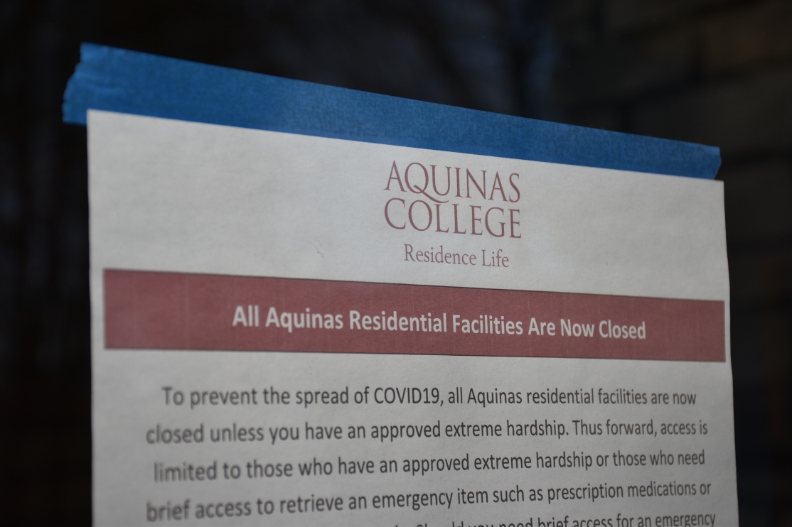 """Sign reading """"All Aquinas Residential Facilities Are Now Closed"""""""